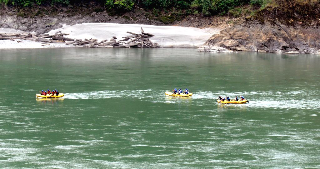 Rafting teams participate in the inaugural function of the 1st Arunachal Spring Carnival in Pasighat in East Siang district of Arunachal Pradesh on March 17, 2015.