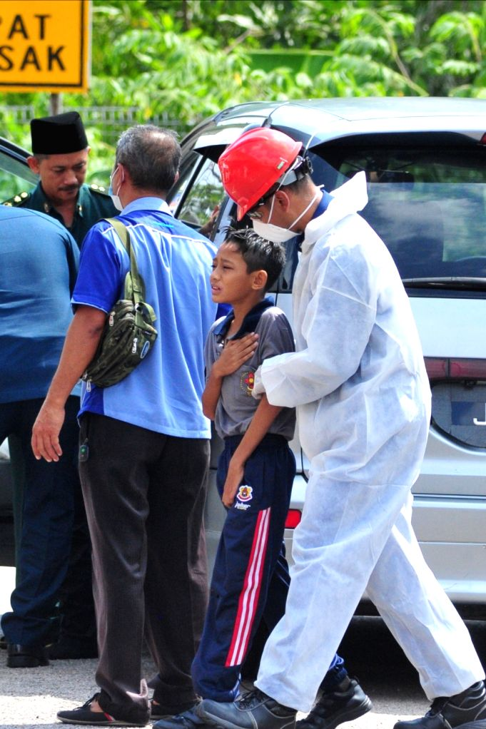 PASIR GUDANG, March 14, 2019 - A student is sent to a hospital due to the pollution in Pasir Gudang, state of Johor, Malaysia, March 13, 2019. Malaysian Prime Minister Mahathir Mohamad said on ... - Mahathir Mohamad