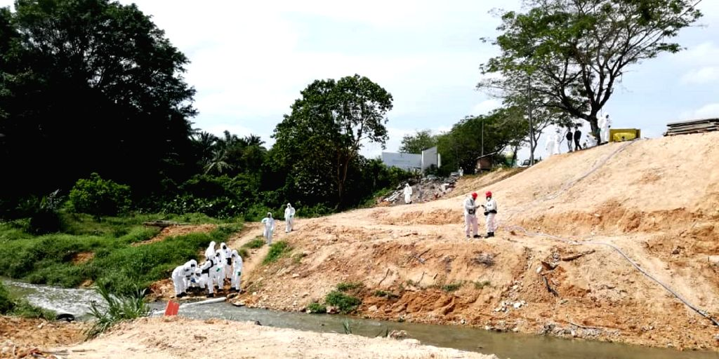 PASIR GUDANG, March 14, 2019 - Environmental department workers inspect a river in Pasir Gudang, state of Johor, Malaysia, March 13, 2019. Malaysian Prime Minister Mahathir Mohamad said on Thursday ... - Mahathir Mohamad