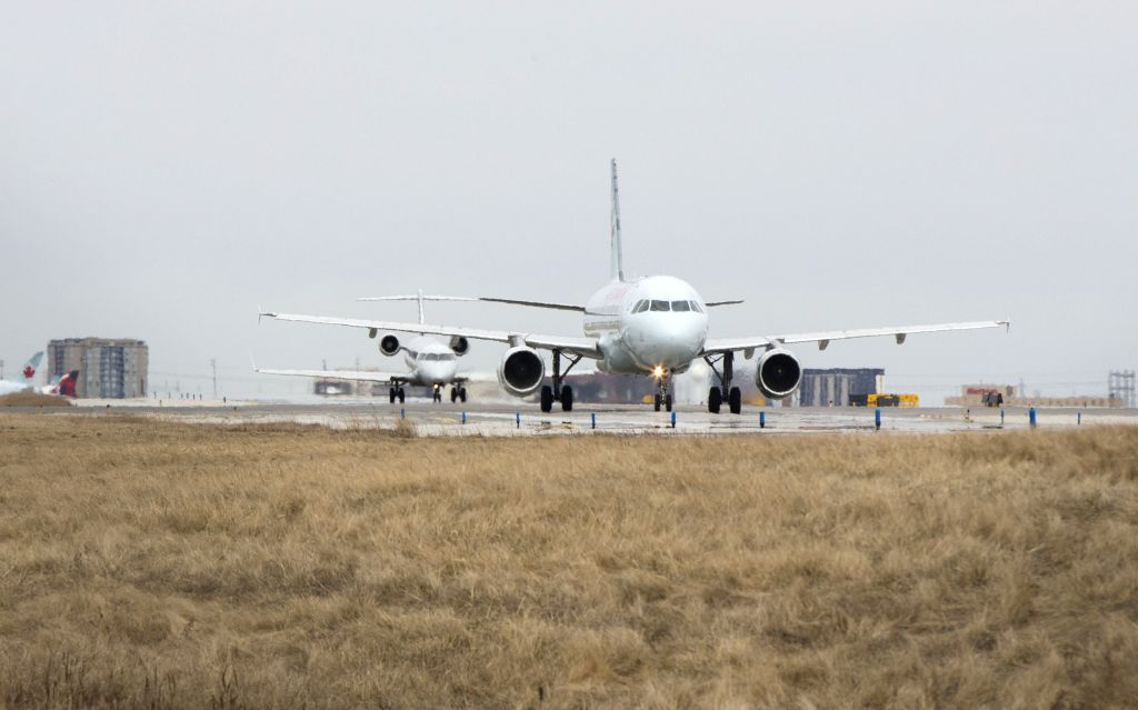 Passenger planes wait to take off at Pearson International Airport in Toronto, Canada, March 18, 2020. Canadian Prime Minister Justin Trudeau announced that the ... - Justin Trudeau