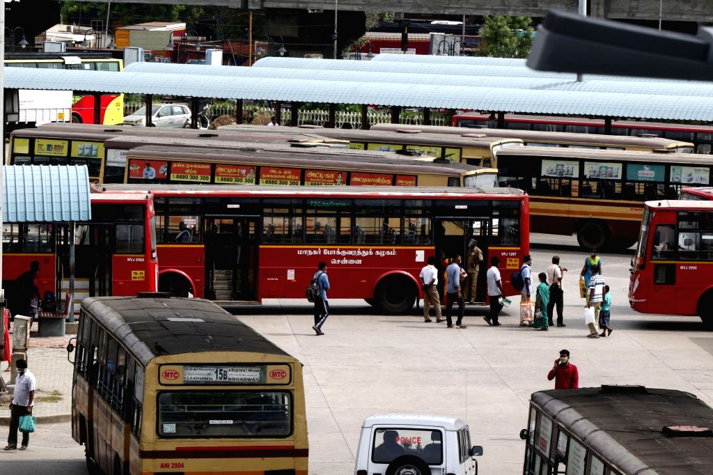 Passengers arrive at a bus depot to board buses to their respective destinations after the Tamil Nadu Government permitted the resumption of public transport services across the state, in ...