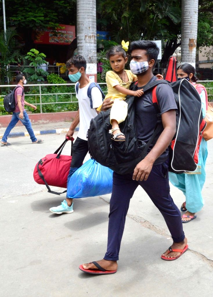 Passengers arrive at the Bengaluru City Railway Station from their native during the partial coronavirus lockdown , in Bengaluru on Wednesday 16th June 2021