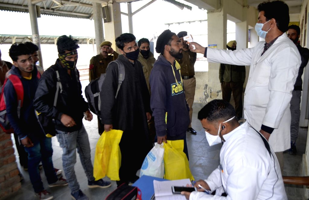 Passengers being screened for COVID-19 at Baramulla railway station amid coronavirus pandemic, in Jammu and Kashmir's Baramulla on March 18, 2020.