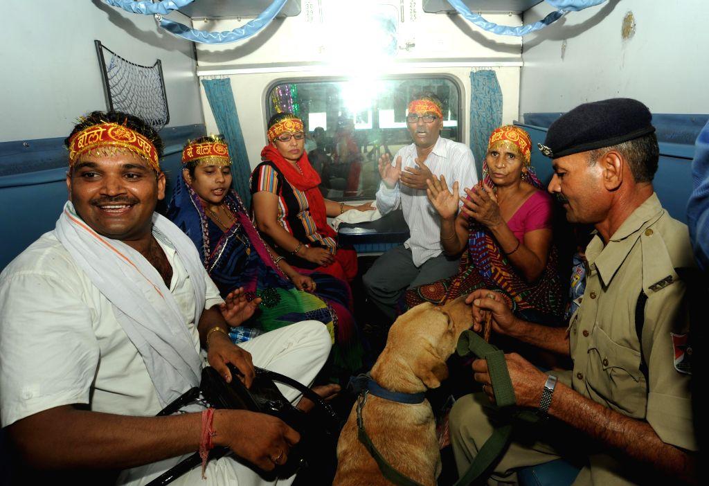 Passengers en-route to Mata Vaishno Devi Shrine aboard Shri Shakti Express which left for Mata Vaishno Devi railway station (Katra) on July 14, 2014. The train will reach its destination at 5.10 am ..
