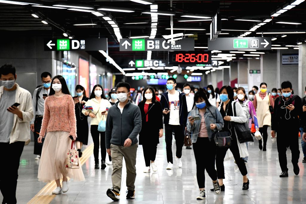Passengers enter a subway station in Shenzhen, south China's Guangdong Province, March 18, 2020. Some of the city's subway stations, which were often overwhelmed ...