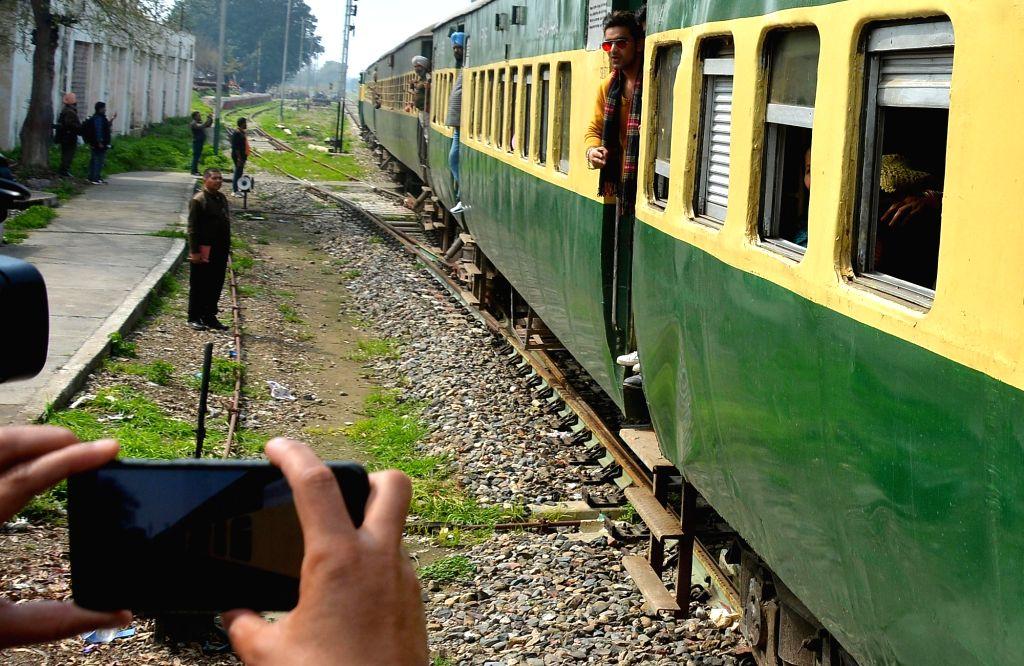 Passengers from Pakistan arrive at Attari railway station from Samjhauta Express, in Punjab, on March 4, 2019.