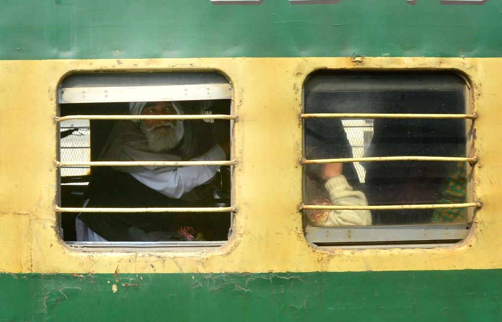 Passengers from Pakistan arrive at Attari railway station from Samjhauta Express, in Punjab, on March 4, 2019.