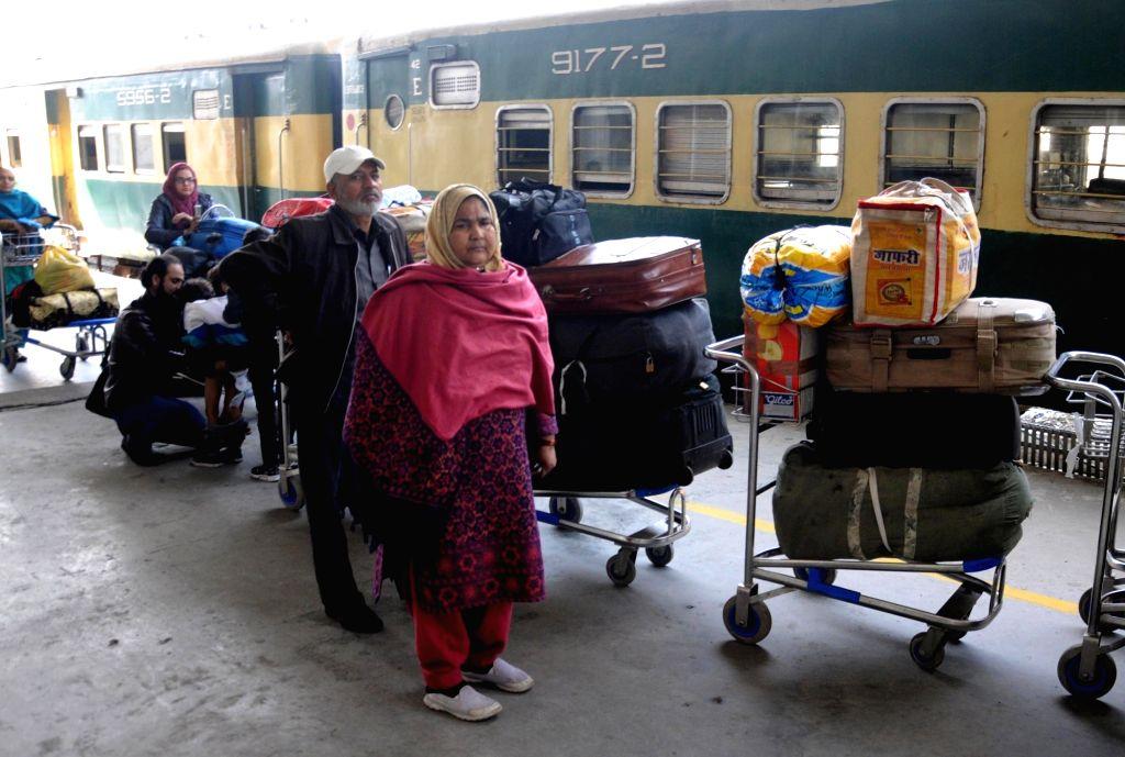 Passengers of Samjhauta Express arriving from Pakistan deboard at Attari railway station, in Punjab, India  on Feb 25, 2019.
