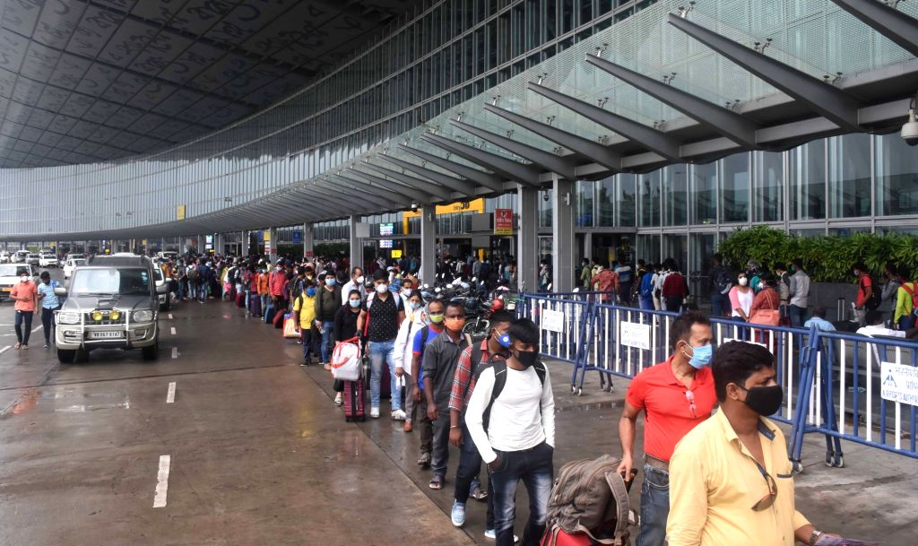 Passengers queue up at the the course departure lounge of Netaji Subhash Chandra Bose International Airport in Kolkata on Sep 1, 2020. The West Bengal government has permitted airlines to ...