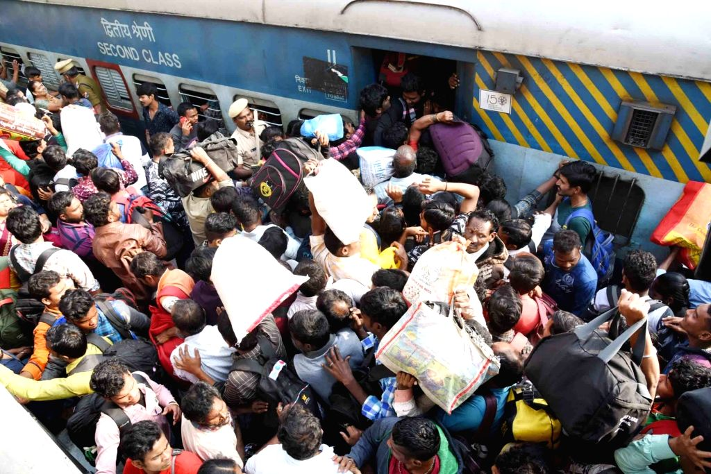 Passengers rush to board a Makar Sankranti special train at the Secunderabad station on Jan 12, 2020.