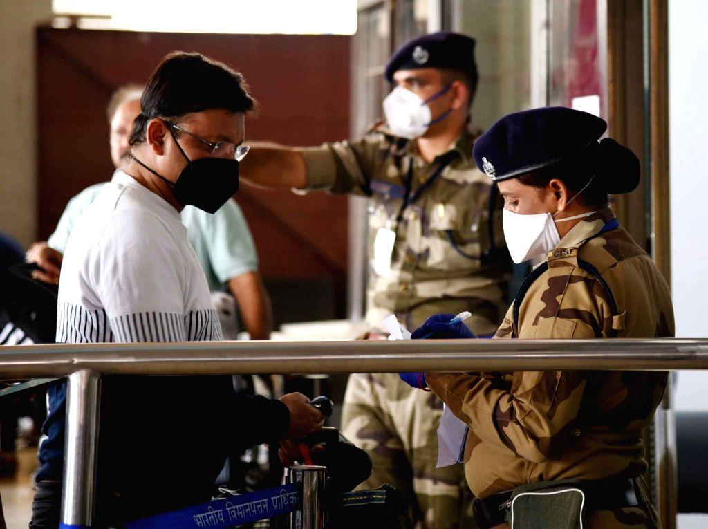 Passengers seen wearing masks as a precautionary measure against COVID-19 amid coronavirus pandemic, at Jay Prakash Narayan International Airport in Patna on March 20, 2020.