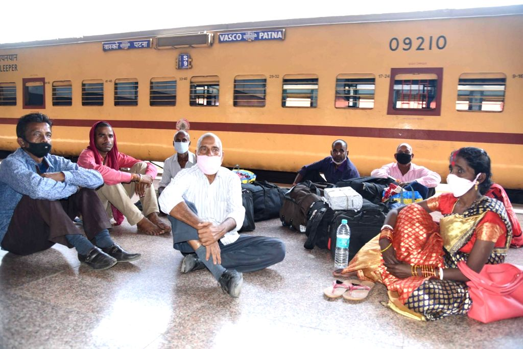 Passengers seen wearing masks as a precautionary measure against COVID-19 amid coronavirus pandemic at Patna Junction Railway Station on March 20, 2020.