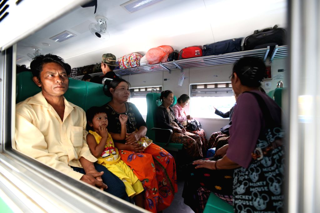 Passengers sit on a new express train before setting out during the new sectional express trains launching ceremony in Yangon, Myanmar, Jan. 18, 2016. Two new ...