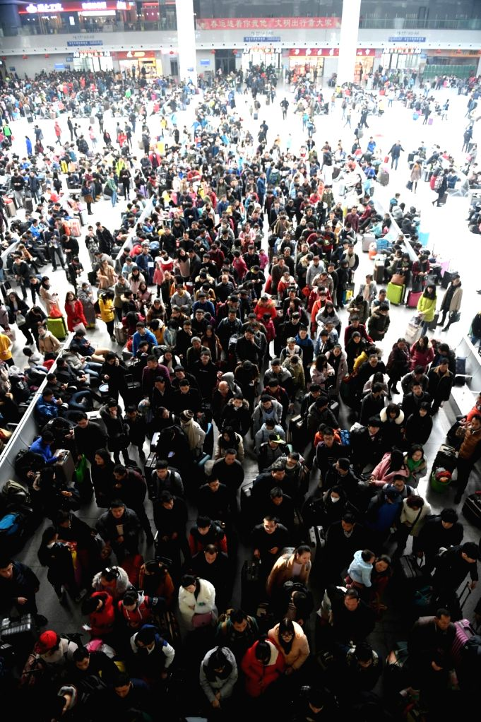 Passengers stay in the waiting hall to enter the platform at Nanchang Railway Station in Nanchang, capital of east China's Jiangxi Province, Jan. 13, 2017. About 2.98 billion trips are ...