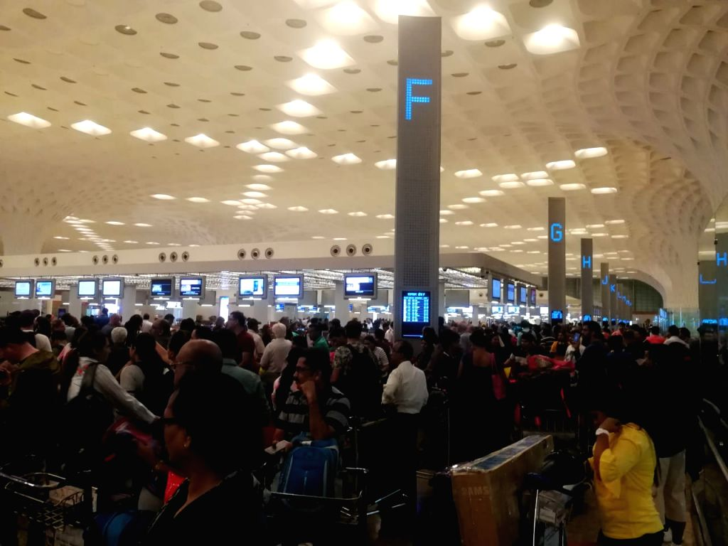 Passengers wait at Mumbai International airport as flight operations of Air India stalled due to a glitch on April 27, 2019.( Photo: IANS)
