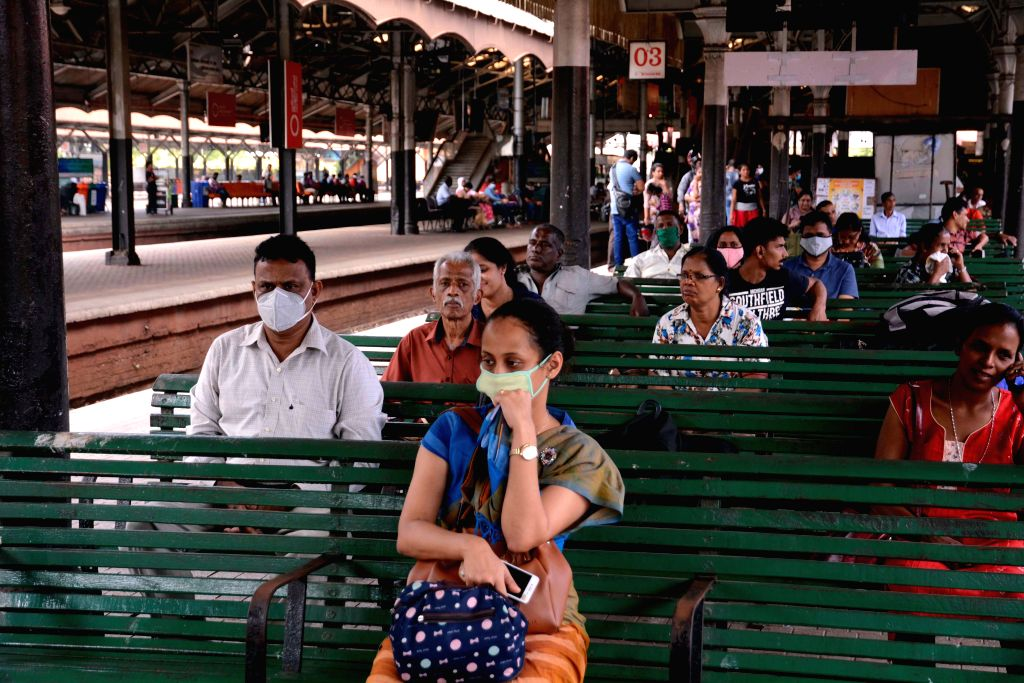 Passengers wait for trains at the railway station in Colombo, Sri Lanka, on March 18, 2020. Sri Lanka has so far confirmed 43 positive COVID-19 patients while 200 ...