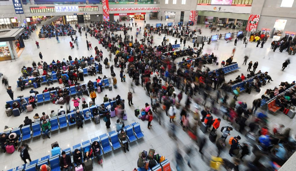 Passengers wait to board at Changchun Railway Station in Changchun, capital of northeast China's Jilin Province, Jan. 13, 2017. About 2.98 billion trips are expected to be made during China's ...