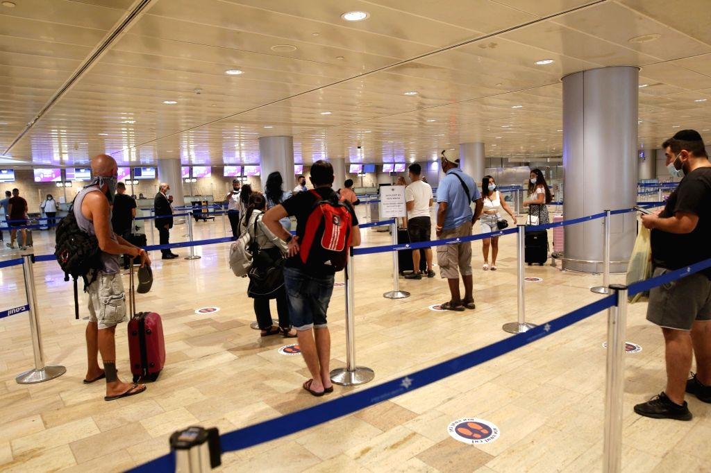 Passengers wait to check in at Ben Gurion International Airport near central Israeli city of Tel Aviv on Aug. 13, 2020.   Israel's Ministry of Health reported ...