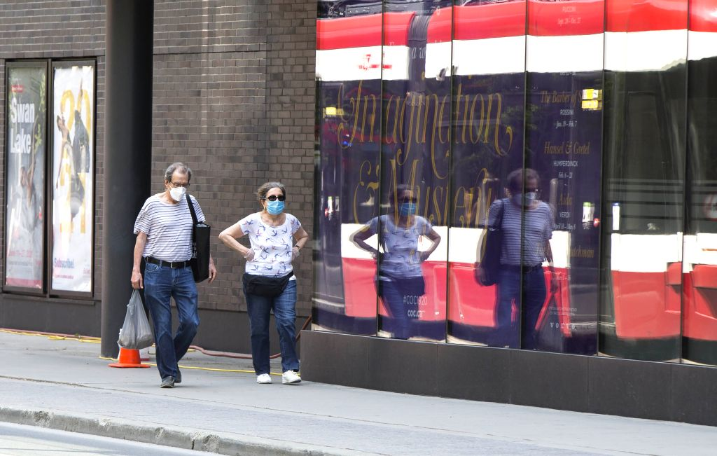 Passengers wearing face masks are seen after getting off a streetcar in Toronto, Canada, on July 2, 2020. The Toronto Transit Commission (TTC) required riders to ...
