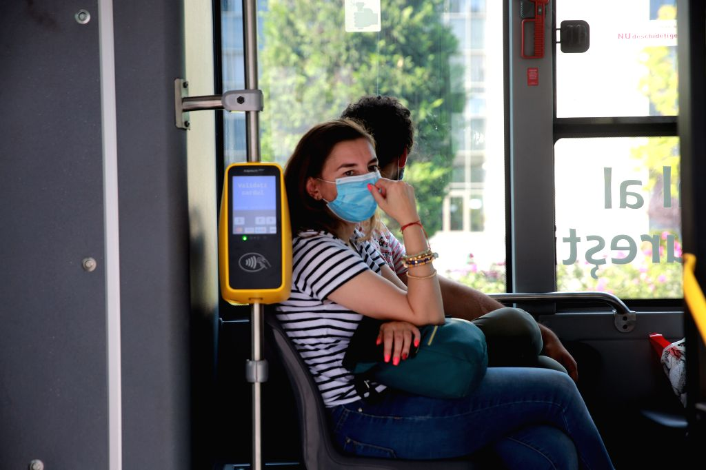 Passengers wearing face masks are seen on a bus in Bucharest, Romania, on August 1, 2020. Mask-wearing is being made mandatory in crowded outdoor public places in ...