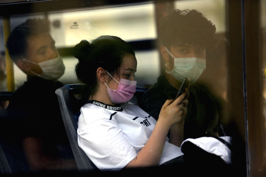 Passengers wearing face masks are seen on a bus in Ankara, Turkey, on Aug. 11, 2020. Turkey confirmed 1,183 new COVID-19 cases on Tuesday, raising the total ... - Fahrettin Koca