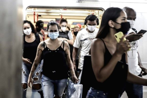 Passengers wearing face masks disembark from a subway car in Sao Paulo, Brazil on March 22, 2021.