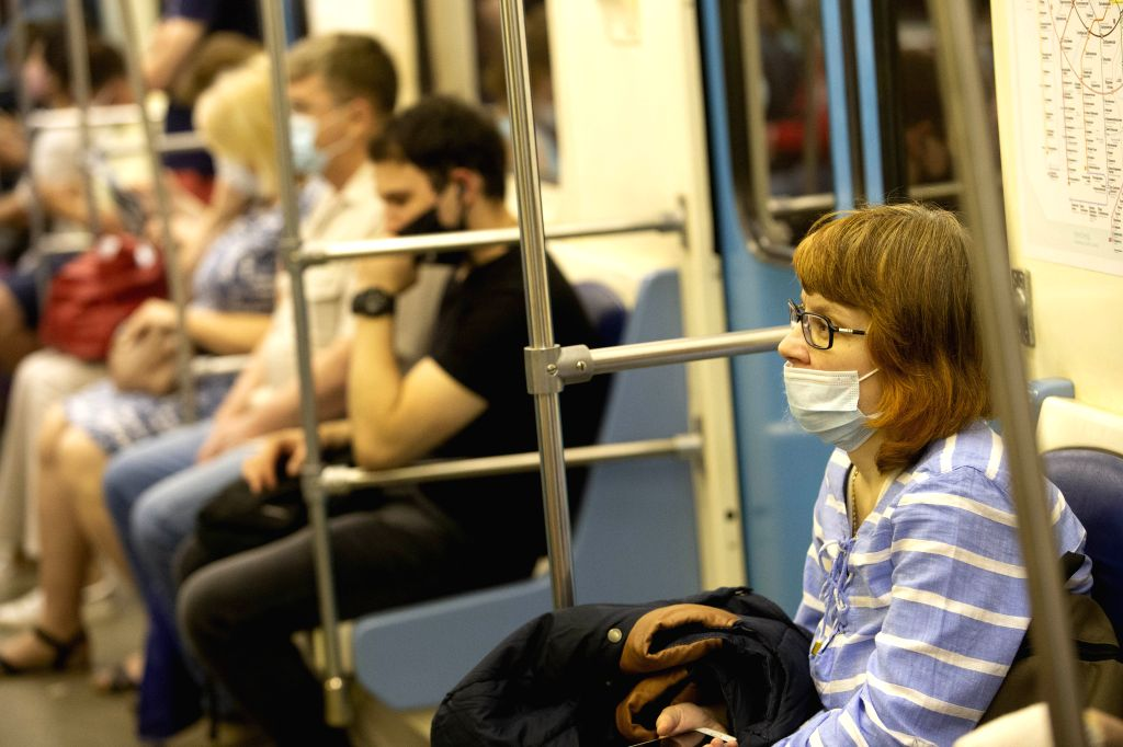 Passengers wearing face masks sit in the subway train in Moscow, Russia, on June 23, 2020. Russia recorded 7,425 COVID-19 cases in the past 24 hours, taking its ...