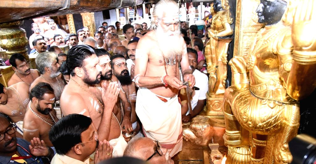 : Pathanamthitta: The melsanthi (head priest), A.V. Unnikrishnan Namboodiri during opening of Sabarimala temple during Thulam Pooja at Sabarimala Temple in Kerala's Pathanamthitta district on ...