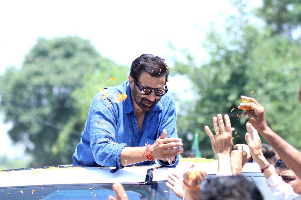 Pathankot: BJP's Lok Sabha candidate from Gurdaspur, Sunny Deol during a roadshow for the forthcoming Lok Sabha polls, in Pathankot, on May 12, 2019. (Photo: IANS)
