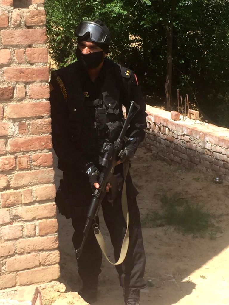 Patiala: Personnel of Special Operation Group (SOG) in action to flush out the 'nihangs' from the Dera Complex at village Balbera in Patiala district on Apr 12, 2020. (Photo: IANS)