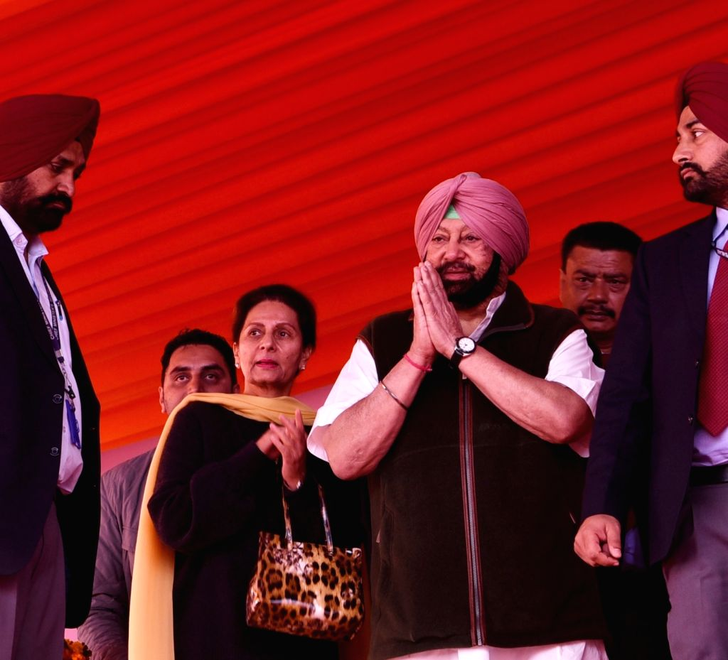 Patiala: Punjab Chief Minister Captain Amarinder Singh and former Union Minister Preneet Kaur during a programme organised to provide debt relief to farmers under the state government's debt relief scheme at Baran village of Patiala in Punjab on Dec  - Captain Amarinder Singh and Preneet Kaur
