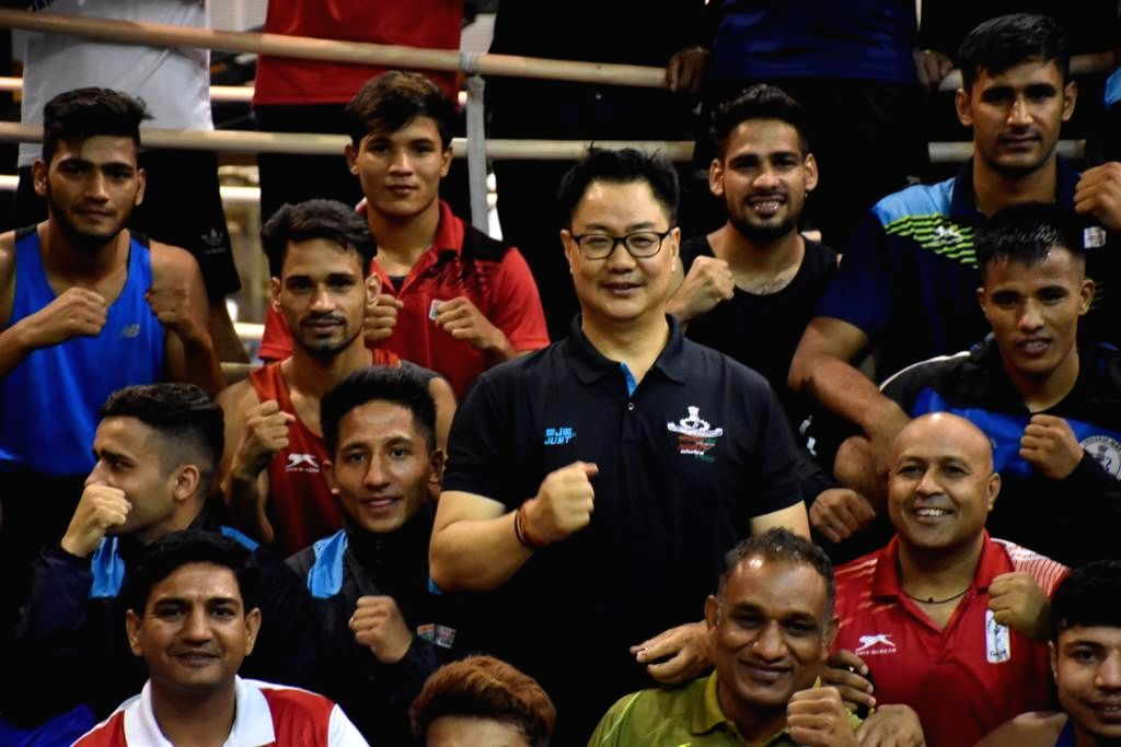 Patiala: Union Sports Minister Kiren Rijiju with the Indian Men's Boxing team during his maiden visit to the Netaji Subhas National Institute of Sports to take stock of the boxing preparations ahead of the 2020 Tokyo Olympics, in Punjab's Patiala on  - Kiren Rijiju