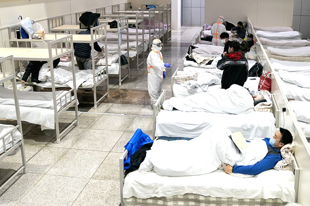 Patients infected with the novel coronavirus are seen at a makeshift hospital converted from an exhibition center in Wuhan, central China's Hubei Province, Feb. 5, ...