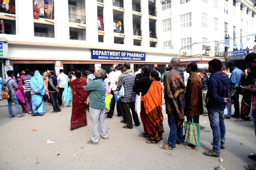 Patients queue up outside a hospital for medical treatment in Kolkata on Feb 1, 2018. With an emphasis on health besides agriculture and rural economy, infra and senior citizens in the Union ... - Arun Jaitley