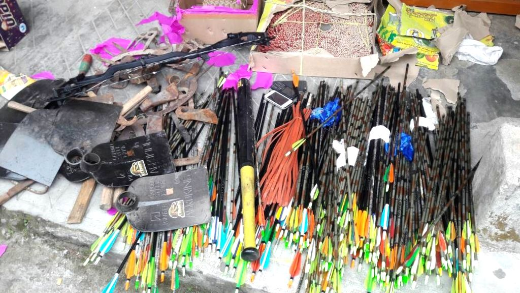 Patlebas: Arms seized by police from GJM chief Bimal Gurung's house in Patlebas in Darjeeling district during a raid on June 15, 2017. Bow and arrows, knives, axes and cartridges were seized from the house. (Photo: IANS)