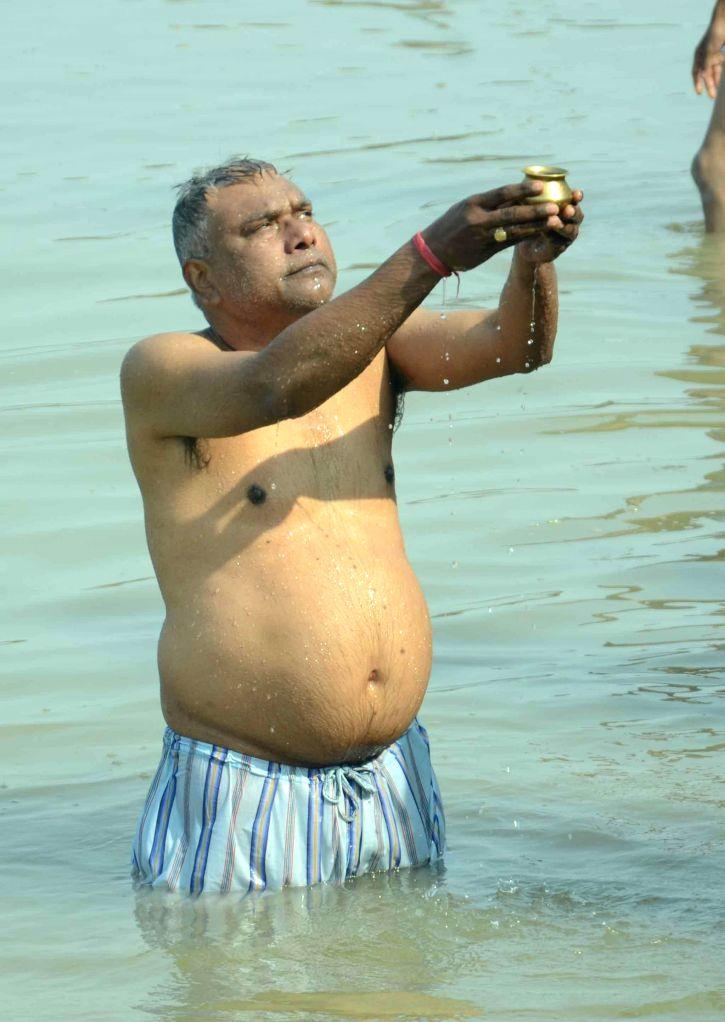 A man performs rituals in the Ganga river on Makar Sankranti in Patna, on Jan 14, 2015.