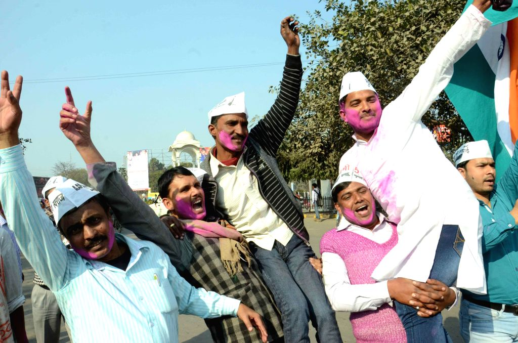 Aam Aadmi Party (AAP) workers celebrate party's victory in the recently concluded Delhi Assembly Polls in Patna, on Feb 10, 2015.