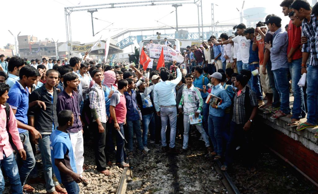 AISA activists demonstrate on railway tracks at Rajendra Nagar station in Patna on Nov. 15, 2014.