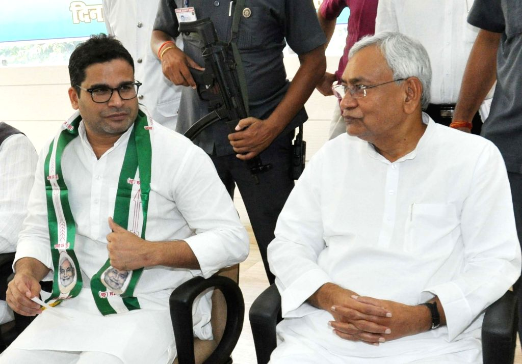 Patna: Bihar Chief Minister and JD-U chief Nitish Kumar with election strategist Prashant Kishor during a programme where the latter joined JD-U, in Patna on Sept 16, 2018. Kishor, 41-year-old former UN official, who founded the Indian Political Acti - Nitish Kumar