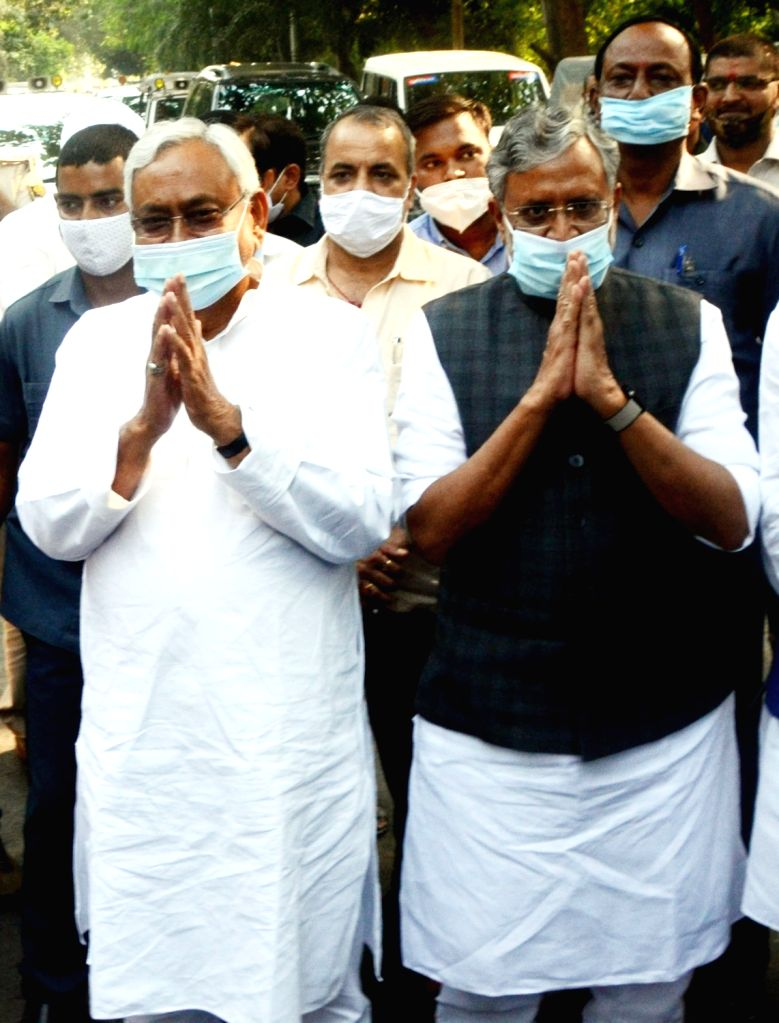 Patna: Bihar Chief Minister and JD-U National President Nitish Kumar and Deputy Chief Minister and BJP leader Sushil Kumar Modi leave after attending NDA meeting in Patna, on Nov 13, 2020. (Photo: IANS) - Nitish Kumar and Sushil Kumar Modi