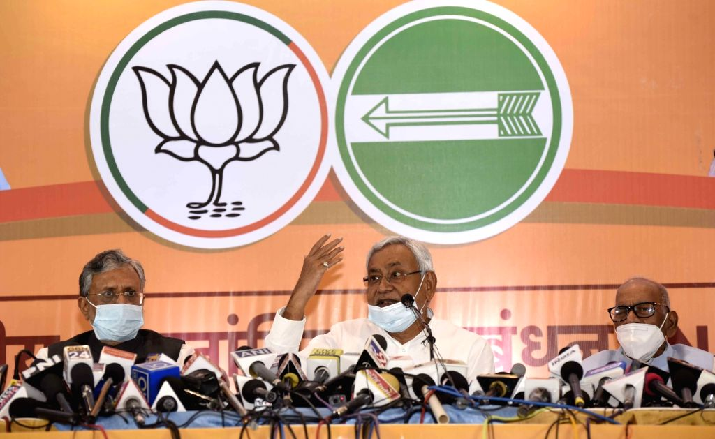 Patna: Bihar Chief Minister and JD-U President Nitish Kumar accompanied by Deputy Chief Minister and BJP leader Sushil Kumar Modi, addresses a press conference held by NDA parties ahead of Bihar Assembly elections, in Patna on Oct 6, 2020. (Photo: IA - Nitish Kumar and Sushil Kumar Modi