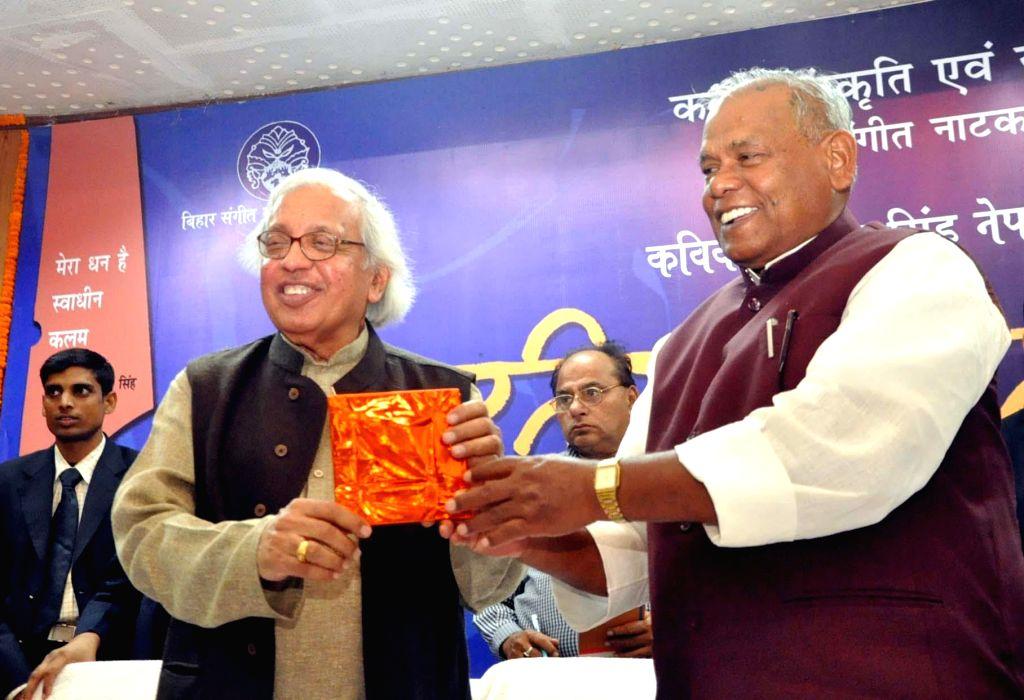 Bihar Chief Minister Jitan Ram Majhi felicitates Hindi poet, critic and editor Ashok Vajpeyi during a programme in Patna, on Nov 21, 2014. - Jitan Ram Majhi