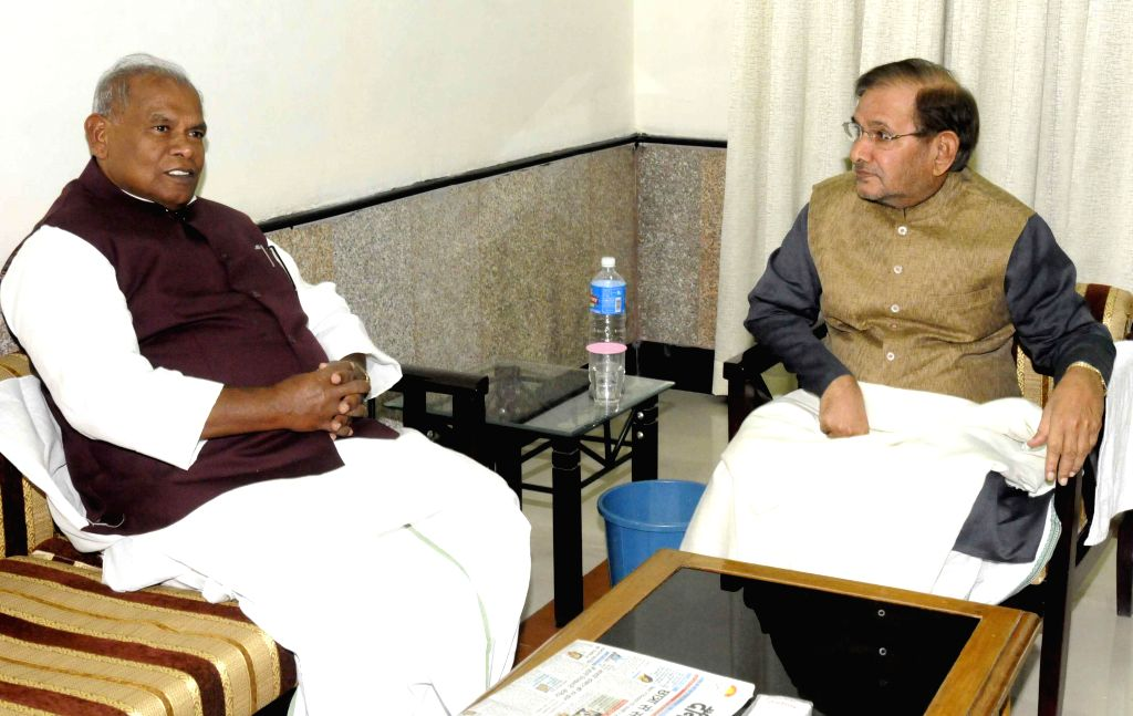 Bihar Chief Minister Jitan Ram Majhi during a meeting with JD (U) chief Sharad Yadav in Patna, on Nov 21, 2014. - Jitan Ram Majhi and Sharad Yadav