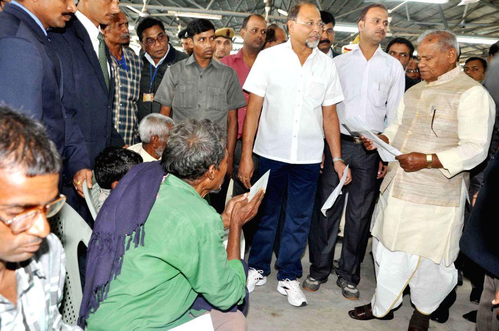 Bihar Chief Minister Jitan Ram Majhi  goes through a letter addressed to him by public at Janta Durbar in Patna on Nov 17, 2014. - Jitan Ram Majhi