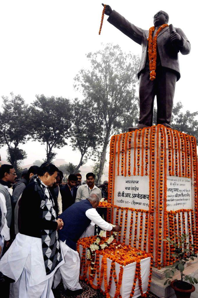 Bihar Chief Minister Jitan Ram Majhi pays tribute to Babasaheb Dr B R Ambedkar on his 59th Mahaparinirvan Diwas in Patna on Dec. 6, 2014. - Jitan Ram Majhi