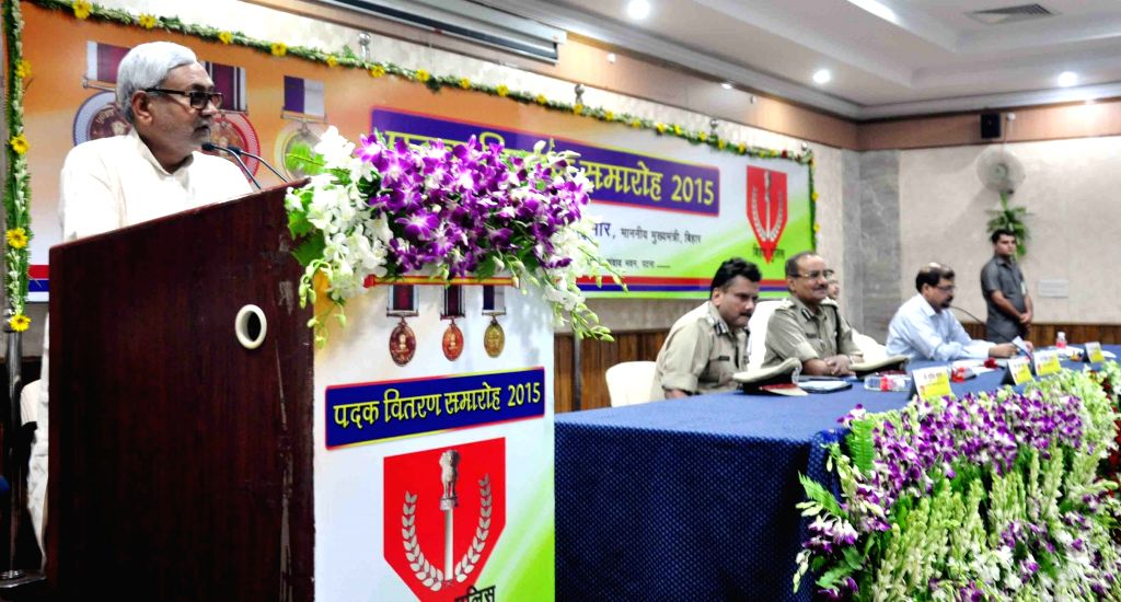 Bihar Chief Minister Nitish Kumar addresses during a programme organised to distribute police medals in Patna, on June 12, 2015.