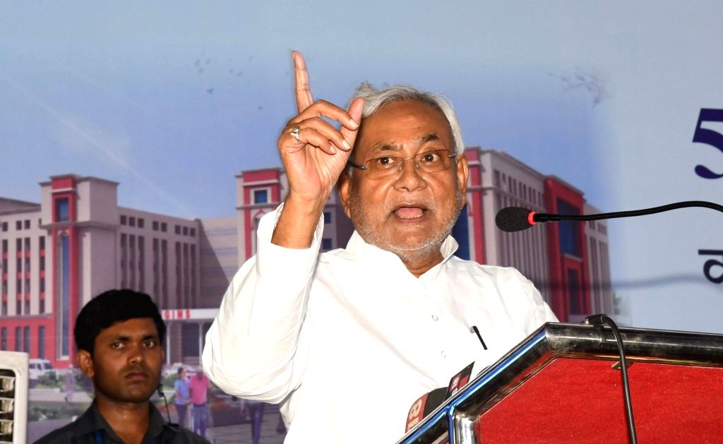 Patna: Bihar Chief Minister Nitish Kumar addresses at the foundation stone laying ceremony of a 500 bedded hospital at Indira Gandhi Institute of Medical Sciences in Patna on June 11, 2019. (Photo: IANS) - Nitish Kumar and Indira Gandhi Institute