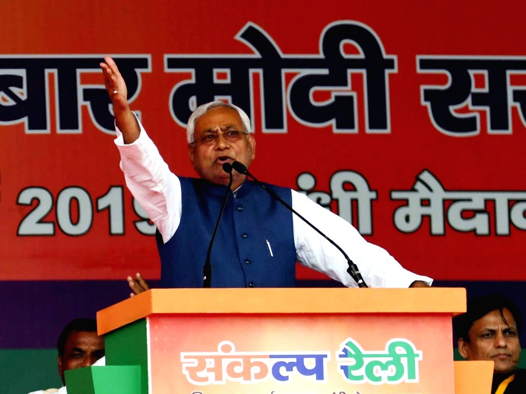 Patna: Bihar Chief Minister Nitish Kumar addresses at the 'Sankalp Rally' of Prime Minister Narendra Modi, in Patna, on March 3, 2019. (Photo: IANS) - Nitish Kumar and Narendra Modi