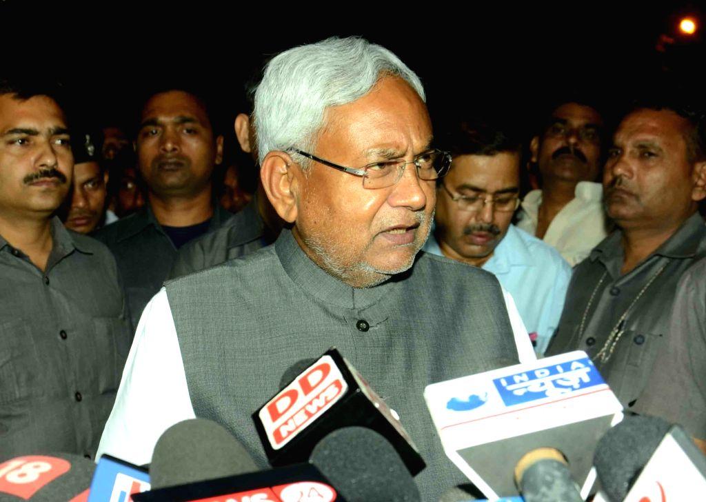 :Patna: Bihar Chief Minister Nitish Kumar addresses press in Patna on Nov 14, 2015. (Photo: IANS).