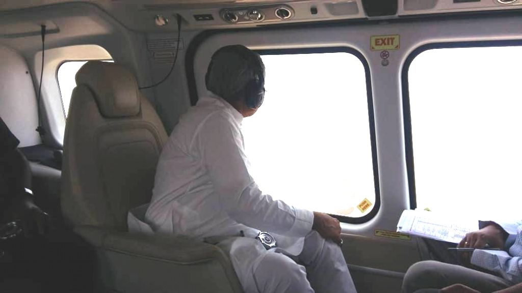 Patna: Bihar Chief Minister Nitish Kumar conducts aerial survey of flood hit areas of the state on July 15, 2019. (Photo: IANS) - Nitish Kumar
